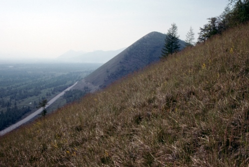 Figure 11. South-facing grassland slopes near Susuman. The Kolymskaya Highway runs below.