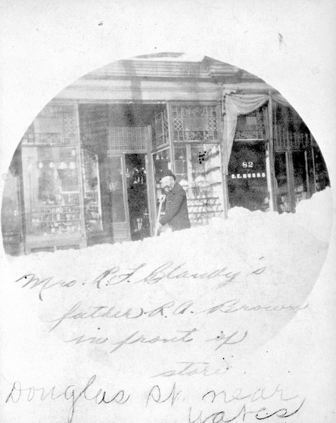 Robert Austen Brown shovelling snow outside businesses on Douglas Street near Yates, Victoria.