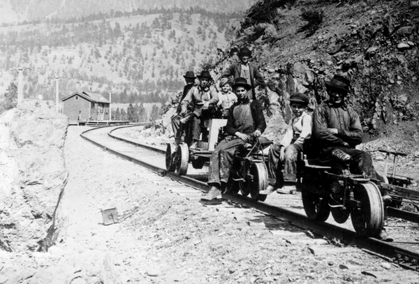 Group on speeders near the Pacific Great Eastern station at Lillooet.