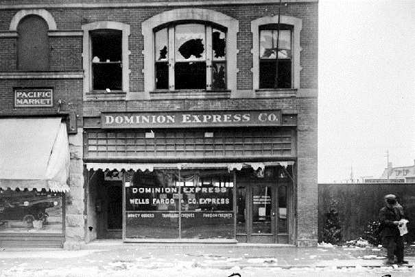 Damage to the German Club above the Dominion Express office, Government and Courtney Streets, Victoria, May 1915. (BC Archives photo A-6827, detail)