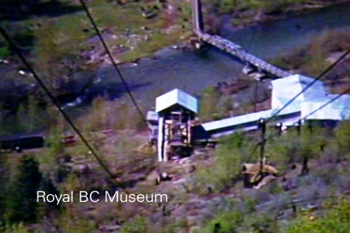 Concentrator and overhead tramway at Yankee Girl Gold Mine, Ymir. ca. 1940. (Digital frame grab from V1999:02/003.02 item #2)