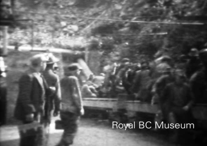 Miners coming off shift at the Britannia Mine, ca. 1926. (Digital frame grab from V1989:48/001.01 item #3.)