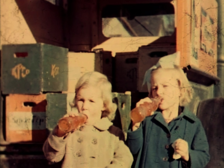 Two young ladies of Kamloops enjoy Silver Tip sodas, ca. 1937-39. (A video frame grab from )