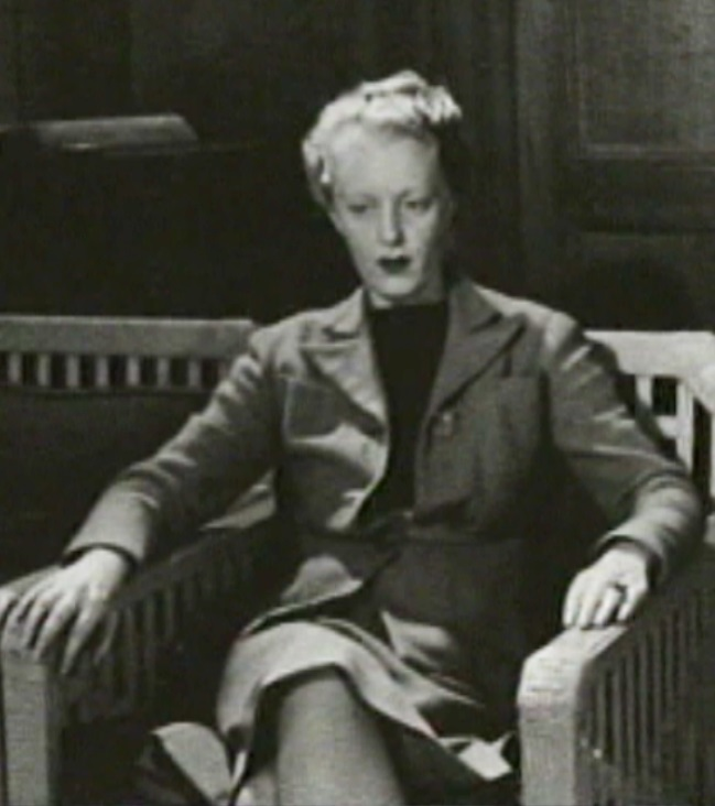 "Dorothy Burritt sitting for the portrait in ""Suite Two"". (Digital frame grab from BC Archives V1989:05/001.01)"