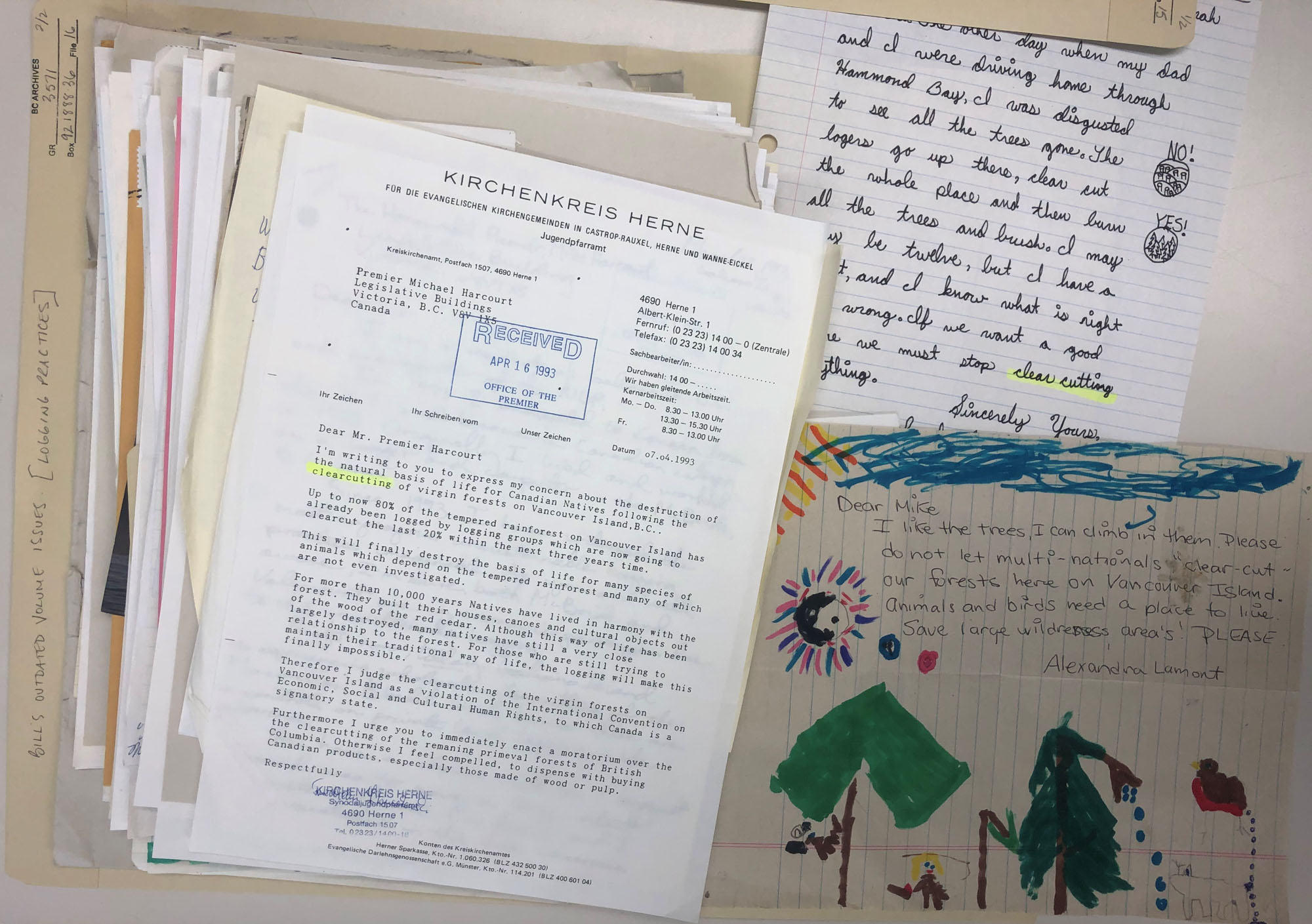 a pile of letters and drawings done by citizens protesting old growth logging